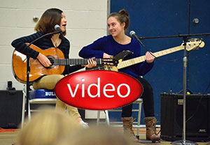 Simone B. and Alejandra W. perform at assembly